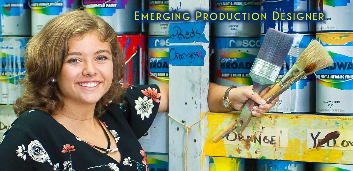 Photo of Addison Cole - Emerging Production Designer holding paint brushes - JMU